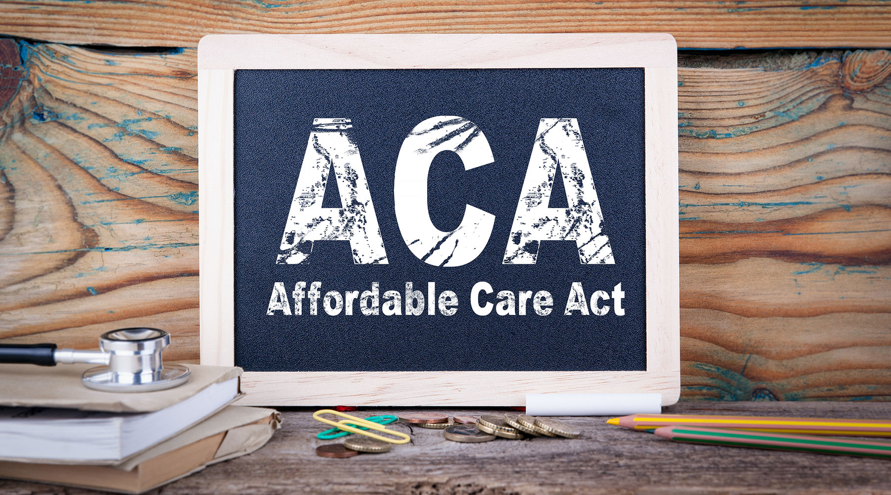 ACA Affordable Care Act written on chalkboard